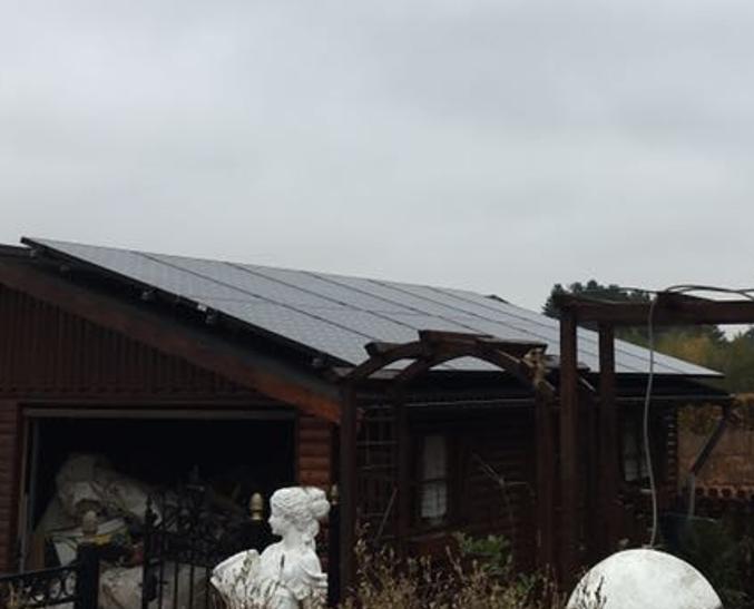 Zonnepanelen op golfplaten dak Langdorp