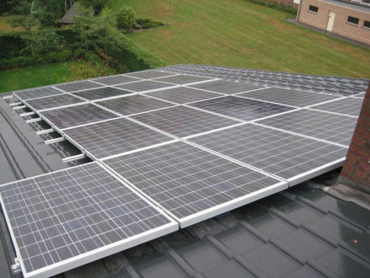 Zonnepanelen op profielplaten dak Lille